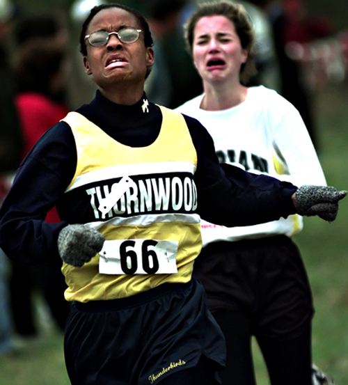 Thornwood High School's Crystal Sanders passes Lisa Lavezzi from Marian Cathloic just before the finish line during a Regional Cross Country Race.