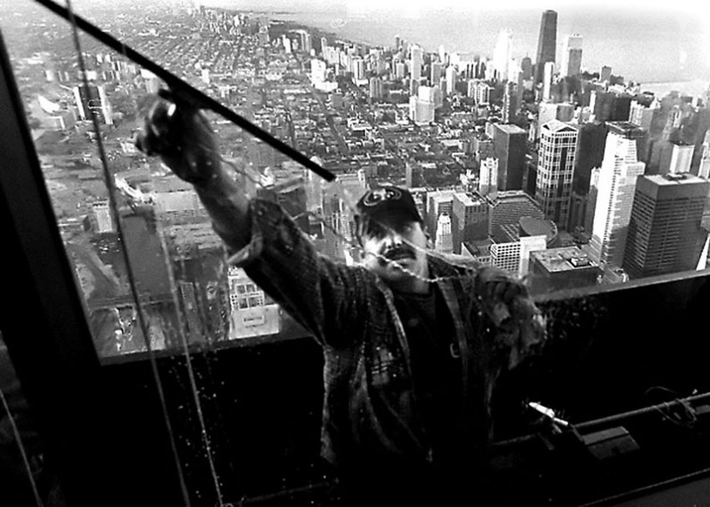 A window washer cleans outside the Willis Tower Skydeck. At 1,353 feet, the Skydeck is the tallest observatory in Chicago.