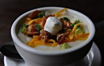 Baked potato soup topped with bacon, Cheddar cheese, green onions and sour cream.