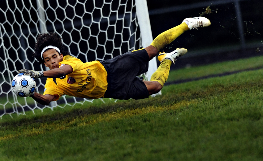 Leyden High School goalie Jose Lopez blocks a shot during a home game against Oak Park-River Forest High School.