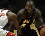 Los Angeles Lakers guard Kobe Bryant drives the ball against Chicago Bulls guard/forward John Salmons.