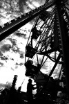 A ferris wheel operator lets people off the ride during the annual Railroad Days event in Franklin Park, Ill.