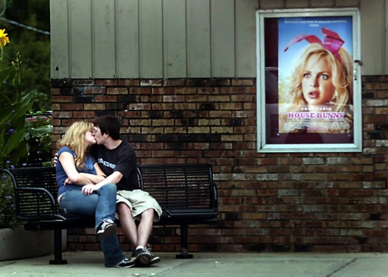 Samantha Hinners and Kyle Magnus kiss outside the Liberty Theater in Libertyville, Ill.